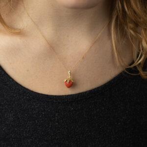 Coral strawberry pendant.